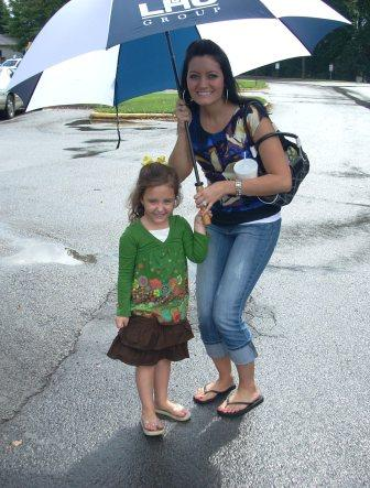 This is my beautiful daughter and granddaughter as we arrived. Thank goodness we brought an umbrella!