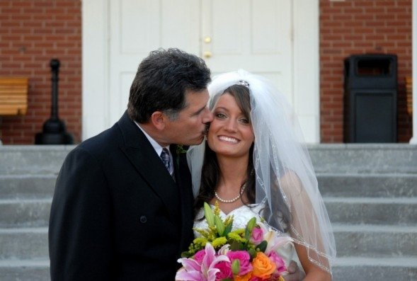 My beautiful daughter on her wedding day getting a smooch from her dad!