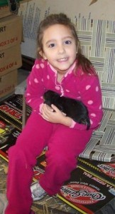 My granddaughter Abby loving on a puppy