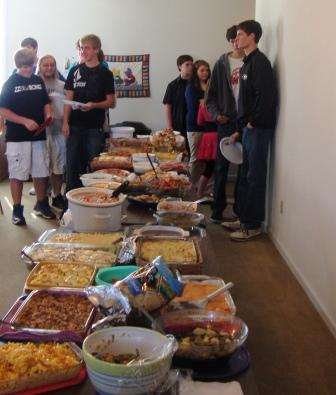 The teens always are ready to pounce on the food but they patiently wait for the blessing!