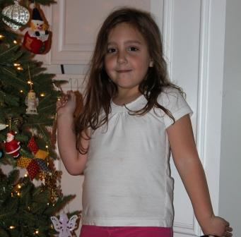 Abby decorating our tree.