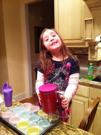 Notice the purple princess cup beside her...Princess Abby making cup cakes!
