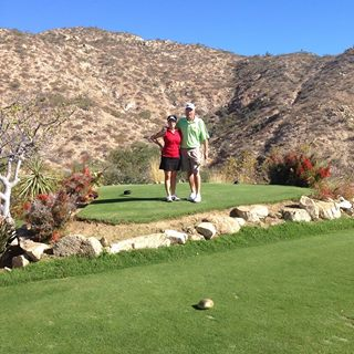 Kate and Gary on golf course