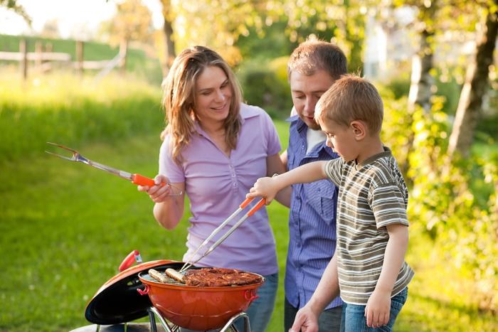 bigstock-family-having-a-barbecue-party-12195740