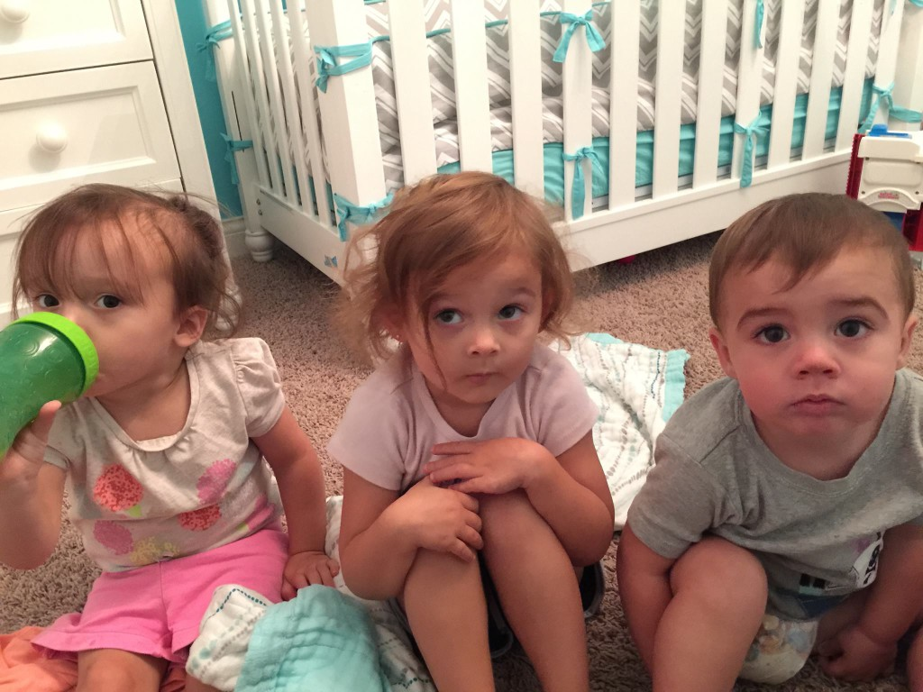 Three of my grandchildren getting ready for story time.