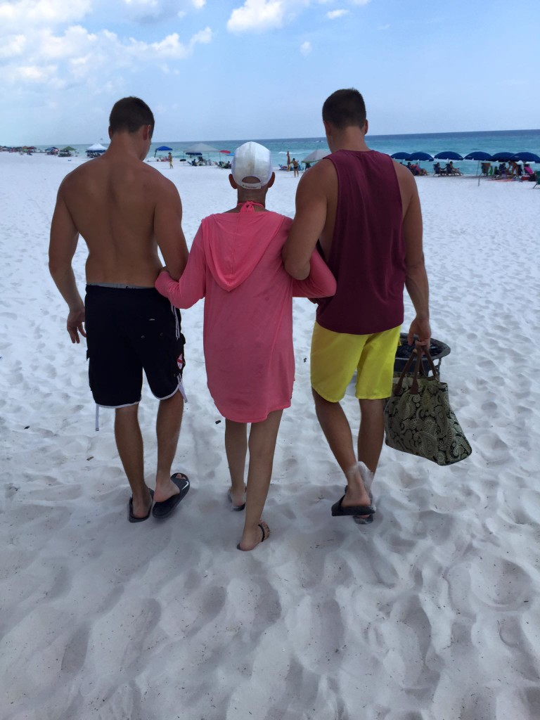 Our twins helping Martha to the beach